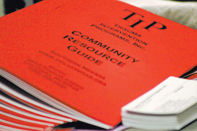 Copies of the Trauma Intervention Program of Southern Nevada's Community Resource Guide. (Ronda Churchill/View file photo)