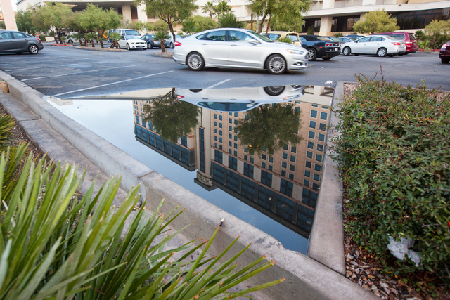 The exterior of The Westin hotel-casino is reflected in a puddle of water as seen at 160 E. Flamingo Road in Las Vegas on Monday, Jan. 12, 2015. (Chase Stevens/Las Vegas Review-Journal)