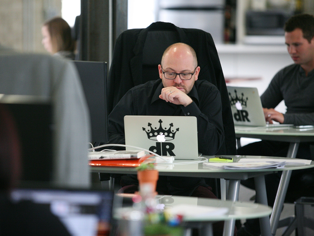 Nate Ludens, center, director of social data, works at Digital Royalty Tuesday, Jan. 20, 2015, in Las Vegas. Digital Royalty, located at 124 South 6th Street, Suite 280, is a social media agency t ...