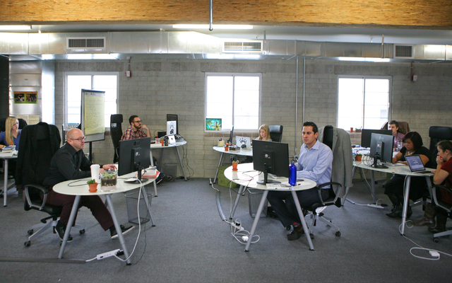 Employees work on projects at Digital Royalty Tuesday, Jan. 20, 2015, in Las Vegas. Digital Royalty, located at 124 South 6th Street, Suite 280, is a social media agency that is working with clien ...