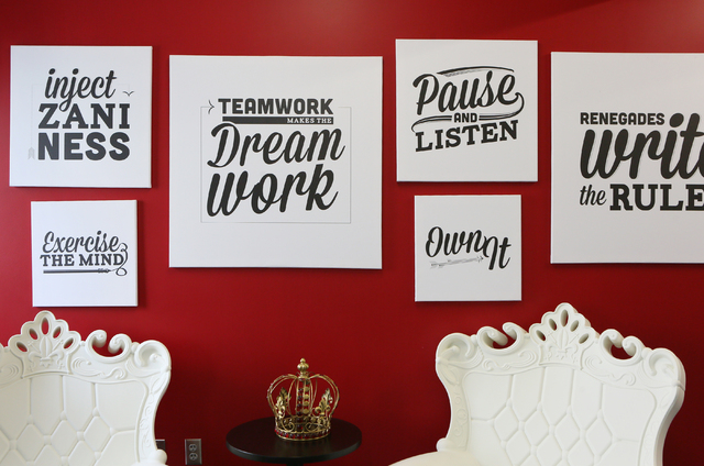 Inspirational signs are posted on a wall at the entrance to Digital Royalty Tuesday, Jan. 20, 2015, in Las Vegas. Digital Royalty, located at 124 South 6th Street, Suite 280, is a social media age ...