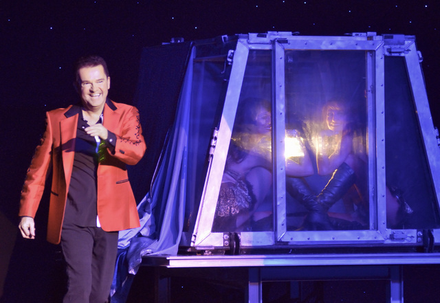 "Magician Dirk Arthur, left, performs with dancers Destiny Johnson, center, and Lauren Metter in ""Dirk Arthur's Wild Illusions"" at the Riviera hotel-casino at 2901 Las Vegas Bl ..."