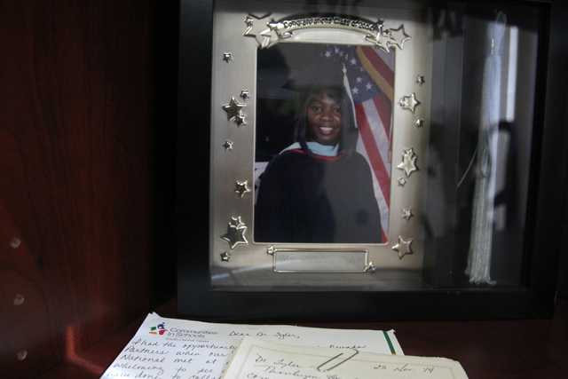 A photo of Tiffany Tyler, chief operations officer for Nevada Partners, is seen inside her office in Las Vegas from her college graduation Monday, Jan. 5, 2015. Tyler, who received her Ph.D from U ...