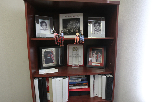 A book shelf displays personal photos and certificates belonging to Tiffany Tyler, chief operations officer for Nevada Partners, at her office in Las Vegas Monday, Jan. 5, 2015. Tyler, who receive ...