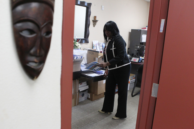 Tiffany Tyler, chief operations officer for Nevada Partners, works at her office in Las Vegas Monday, Jan. 5, 2015. Tyler, who received her Ph.D from UNLV in 2011, dropped out of high school her j ...