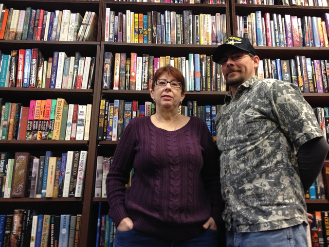 Dragon Castle Books owner Carla Spillman poses for a photo with her son, Danny Brown, at the bookstore, 3142 N. Rainbow Blvd.  in Las Vegas, Dec. 29, 2014. (Sandy Lopez/View) CLICK THE IMAGE FOR M ...