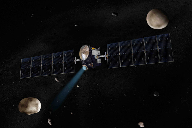 Artist's concept of NASA's Dawn spacecraft. The giant asteroid Vesta, Dawn's next destination, is on the lower left. Another larger asteroid and Dawn's second destination, Ceres, is on the upper r ...