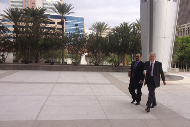 Las Vegas escort service operator Emmanouil Varagiannis, left, arrives at the federal courthouse in Las Vegas with his lawyer, Richard Wright, before pleading guilty to a tax-evasion charge. (Jeff ...