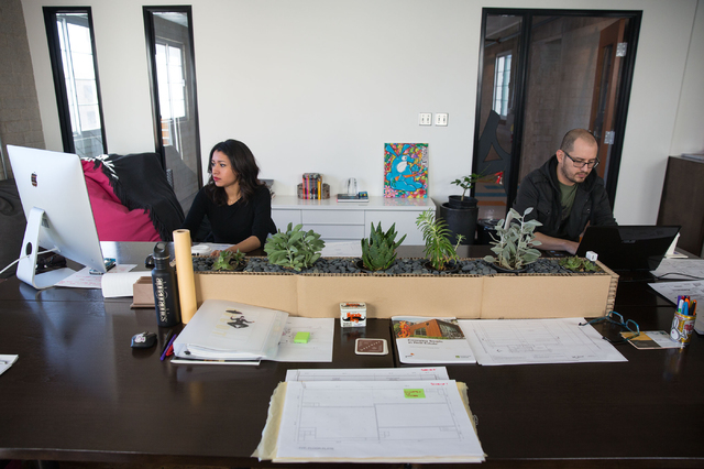 Nina Yanina and Juan Orduz work inside Bunnyfish Studio, 124 S. Sixth St. The firm is responsible for redesigning a growing list of downtown Las Vegas buildings. (Samantha Clemens-Kerbs/View)