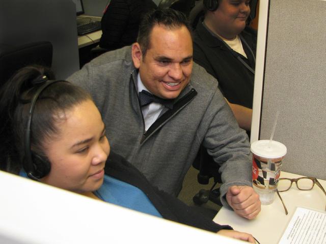 Gabriel Bristol watches as member care representative Marla Torres handles a call Dec. 21. (F. Andrew Taylor/View)