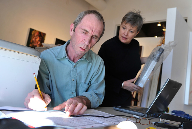 Pete and Marty Walsh tend to their work inside the Trifecta Gallery. The couple are moving to a rural part of Ireland where Pete Walsh grew up and still has family. (David Becker/View)
