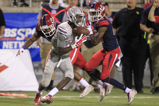 UNLV wide receiver Devonte Boyd pulls in a pass for a first down against Fresno State Friday, Oct. 10, 2014 at Sam Boyd Stadium. UNLV won the game in overtime 30-27. (Sam Morris/Las Vegas Review-J ...