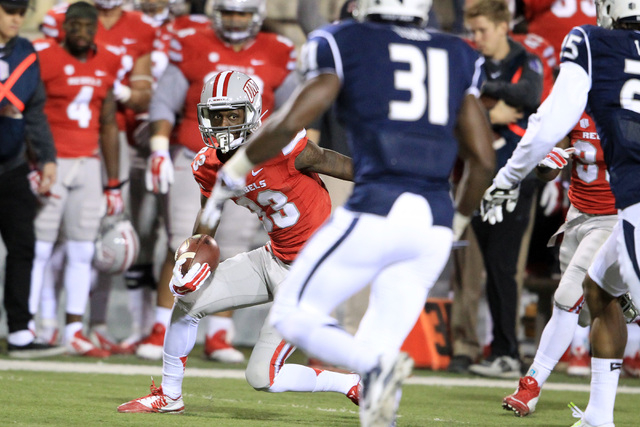 UNLV wide receiver Devonte Boyd looks for a hole in the Nevada defense during their game Saturday, Nov. 29, 2014 at Sam Boyd Stadium. (Sam Morris/Las Vegas Review-Journal)