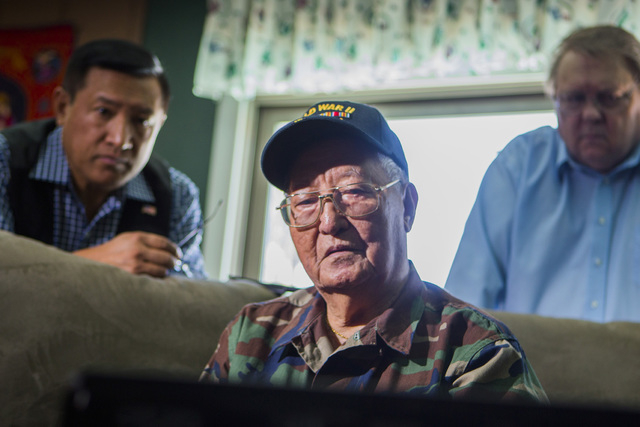 Filipino-American World War II veteran Anastacio Sumajit watches the Committee on Armed Services hearing live stream on  a computer, Tuesday, June 24, 2014. (Jeff Scheid/Las Vegas Review-Journal)