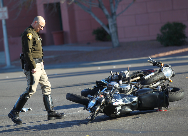 Las Vegas police investigate the scene of a crash involving a motorcycle and a car on Flamingo Road near Maryland Parkway in Las Vegas on Monday, Jan. 19, 2015. (Chase Stevens/Las Vegas Review-Jou ...