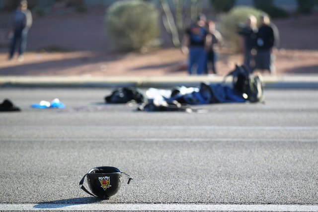 The helmet of a motorcyclist lies on the ground as Las Vegas police respond to the scene of a crash involving a motorcycle and a car on Flamingo Road near Maryland Parkway in Las Vegas on Monday,  ...