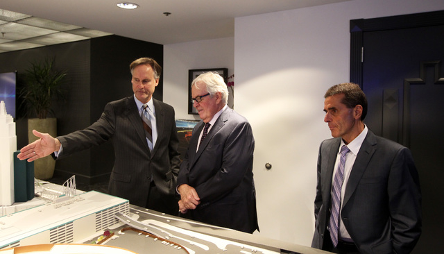 AEG Senior Vice President Mark Faber, left, shows off a model of the new Las Vegas Arena, not pictured, to businessman Bill Foley and Maloof family associate Tony Guanci Thursday, Jan. 15, 2015 at ...