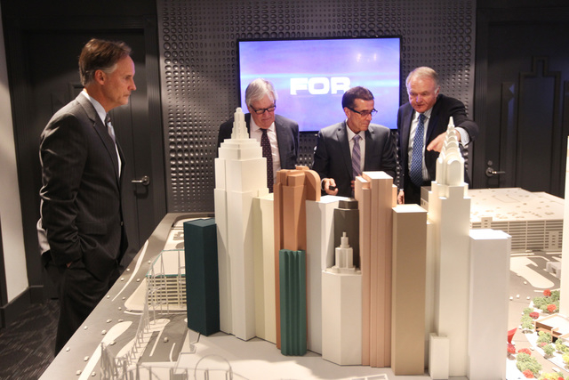 AEG Senior Vice President Mark Faber, left, businessman Bill Foley, Maloof family associate Tony Guanci and Peter Sadowski from Fidelity National Financial look over a model of the Las Vegas Arena ...