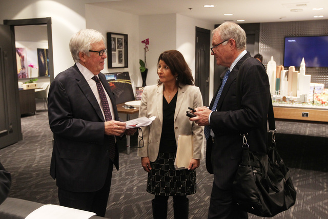 Businessman Bill Foley, left, Michelle Kerch and Peter Sadowski from Fidelity National Financial talk after looking over a model of the new Las Vegas Arena and one of its suite mock ups Thursday,  ...
