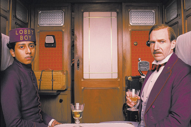 """Tony Revolori, left, is Zero and Ralph Fiennes is Gustave in """"The Grand Budapest Hotel."""" The movie received nine Oscar nominations on Thursday, Jan. 15, 2015, including best picture and nomina ..."""