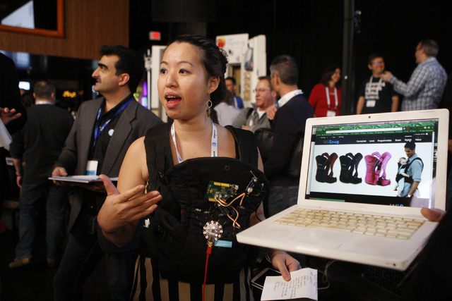 Christy Mahlow, member of the Interactive Design Cafe team, gives a presentation of her bluetooth and Wi-Fi connecting baby carrier WiSnug which monitors a baby's heart beat during the 2015 AT&T H ...