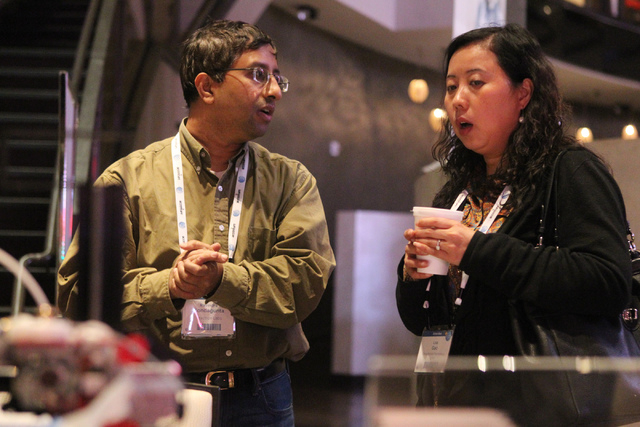 Ravindra Kondagunta, left, speaks to Lisa Gao about his portable 3D printer technology during the 2015 AT&T Hackathon competition at the Palms casino-hotel in Las Vegas Sunday, Jan. 4, 2015. (Erik ...