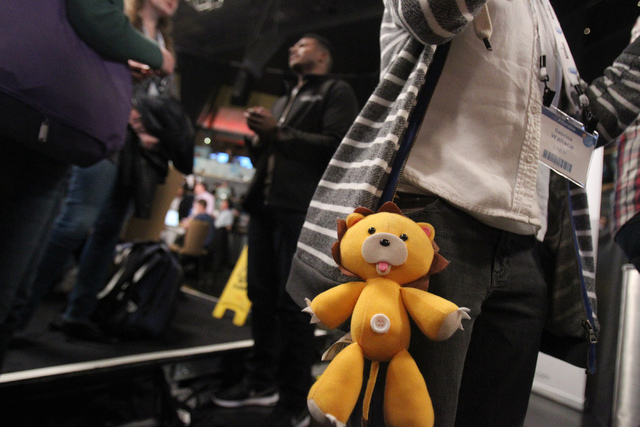 A plush toy hangs from the pocket of Sabrina Wallace as she is interviewed during the 2015 AT&T Developer Summit and Hackathon at the Palms casino-hotel in Las Vegas Sunday, Jan. 4, 2015. Sabrina  ...