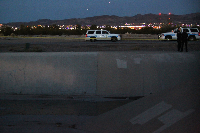 Henderson police investigate a reported body found on a drainage ditch on Wiesner Way near Aspen Peak Loop in Henderson Sunday, Dec. 14, 2014. (Erik Verduzco/Las Vegas Review-Journal)