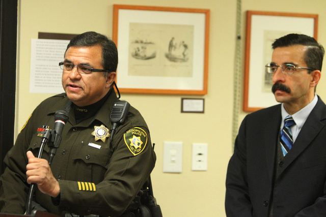 David Cinega, left, director of Hispanic Citizens Academy for the Las Vegas Metropolitan Police Department, with Julian Adem, head consul of the Consulate of Mexico in Las Vegas, speaks during a p ...