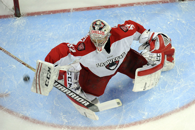 Las Vegas Wranglers goaltender Travis Fullerton makes a blocker save against the Alaska Aces while on a first period power play during their ECHL playoff hockey game at Orleans Arena in Las Vegas  ...