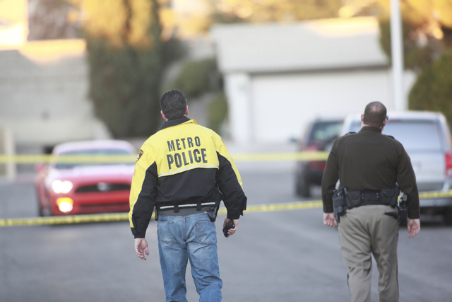 Las Vegas police respond to the scene of a fatal home invasion on the 8000 block of Cactus Flower Court in Las Vegas on Thursday, Jan. 8, 2015. A robbery suspect was shot and killed by a homeowner ...