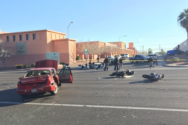 Las Vegas police respond to the scene of a crash involving a motorcycle and a car on Flamingo Road near Maryland Parkway in Las Vegas on Monday, Jan. 19, 2015. (Chase Stevens/Las Vegas Review-Journal)