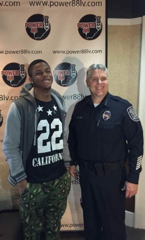 LAs Vegas radio DJ Miles Low poses for a picture with North Las Vegas Chief of Police Joseph Chronister on Tuesday. (Courtesy Chrissie Coon)