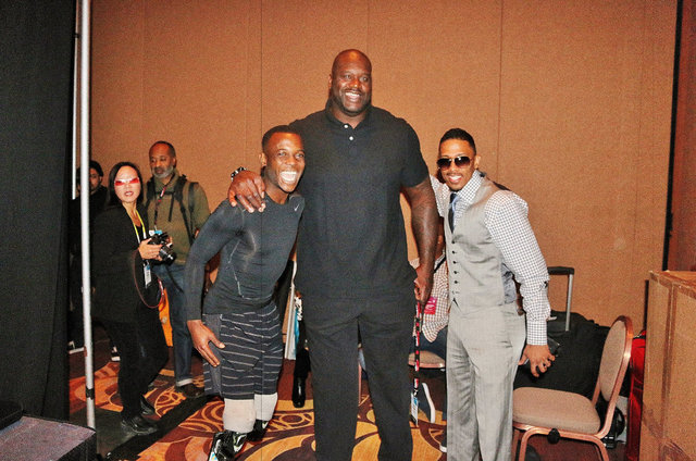 Paralympian Blake Leeper poses with Shaquille O'Neal and Nick Cannon. All three are in Las Vegas to promote headphones for Monster Cable at CES. (Courtesy)