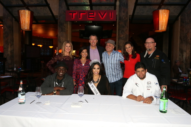 The competitors and judges at a pizza-making contest at Trevi in the Forum Shops. RJ columnist Doug Elfman, standing with the hat, edged out TV news stars Kim Wagner, Olivia Fierro and John Huck,  ...