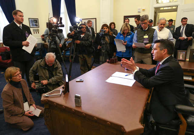 Gov. Brian Sandoval answes media questions following the inauguration at the Capitol, in Carson City, Nev., on Monday, Jan. 5, 2015. (Las Vegas Review-Journal/Cathleen Allison)