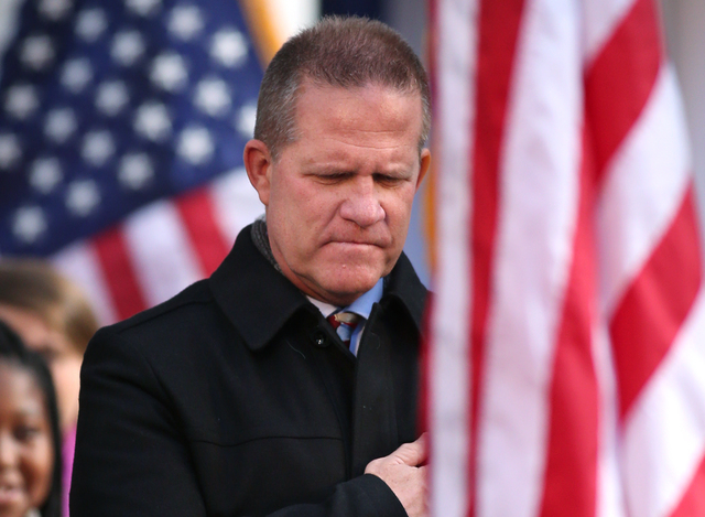 Lt. Gov. Mark Hutchison watches the Presentation of Colors during the inaugural ceremony on the steps of the Capitol, in Carson City, Nev., on Monday, Jan. 5, 2015. (Las Vegas Review-Journal/Cathl ...