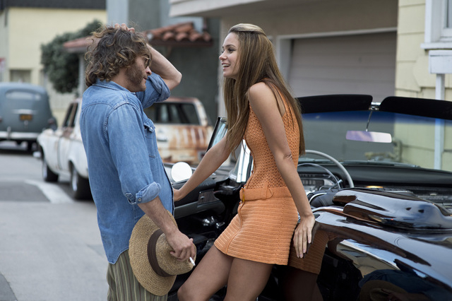"""Joaquin Phoenix as Larry """"Doc"""" Sportello and Katherine Waterston as Shasta Fay Hepworth in Warner Bros. Pictures' and IAC Films' """"Inherent Vice,"""" a Warner Bros. Pictures release. (Courtesy)"""