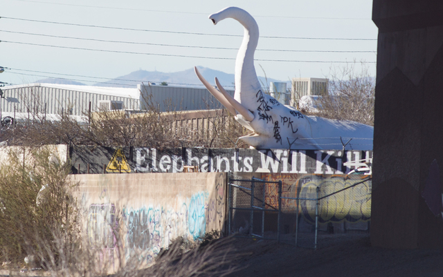 The statue of a charging elephant, which has been around for 30 or so years, is seen on the west side of Interstate 15 between the Cheyenne Avenue and Lake Mead Boulevard exits in Las Vegas on Wed ...