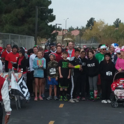 Runners line up for Henderson's inaugural Jingle Bell Run at Pecos Legacy Park, Dec. 20, 2014. (Special to View)