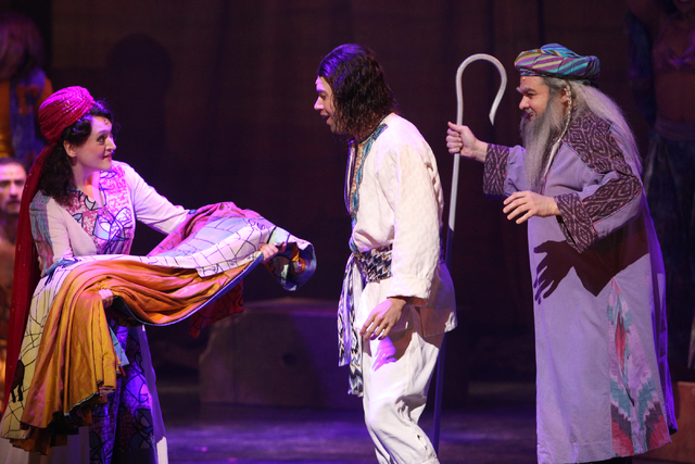Ace Young as Joseph, center, Tricia Tanguy as his mother, left, and William Thomas Evans, right, as Jacob, perform in the touring version of Ҋoseph and the Amazing Technicolor Dreamcoat&#x4e ...