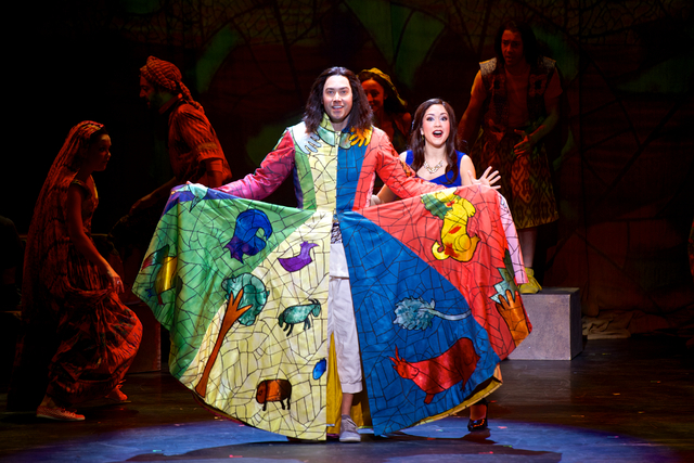 """Joseph (Ace Young) shows off his coat of many colors while the Narrator (Diana DeGarmo) sings """"Jacob & Sons"""" during """"Joseph and the Amazing Technicolor Dreamcoat."""" (Daniel A. Swalec/Courtesy p ..."""
