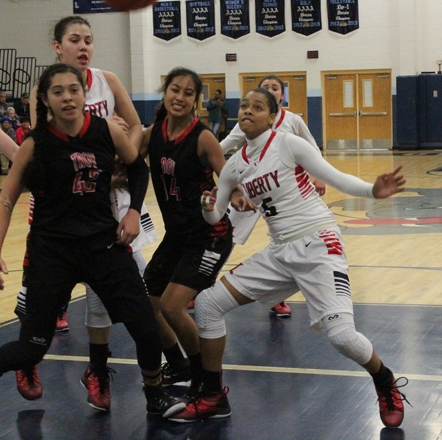 Liberty's Jaelyn Royal battles underneath the basket during the Las Vegas Holiday Classic, at Centennial High School. (W.G. Ramirez/Las Vegas Review-Journal)