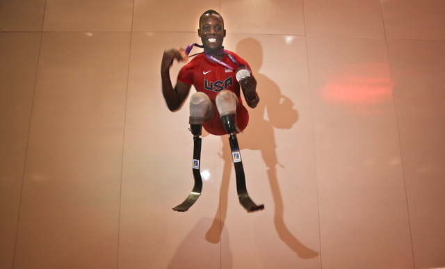 Blake Leeper jumps Tuesday, Jan. 8, 2012 while doing a promotional tour through the Consumer Electronics Show in the Las Vegas Convention Center. The University of Tennessee medical student medale ...