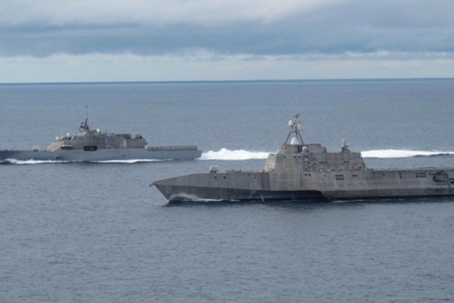 SAN DIEGO (May 2, 2012) The first of class littoral combat ships USS Freedom (LCS 1), left, and USS Independence (LCS 2), maneuver together during an exercise off the coast of Southern California. ...