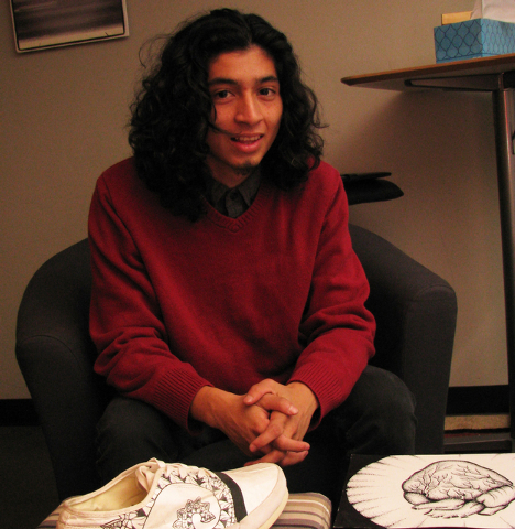 Canyon Springs High School graduate Cristian Lopez designed the pattern that adorns a new shoe made of Tyvek. He poses with a prototype of the shoe and some of his tattoo-inspired art. He was the  ...
