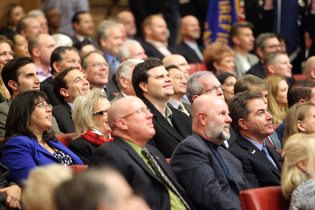 Guests watch a movie before Las Vegas Mayor Carolyn Goodman delivers her State of the City speech at City Hall Thursday, Jan. 8, 2015. (K.M. Cannon/Las Vegas Review-Journal)
