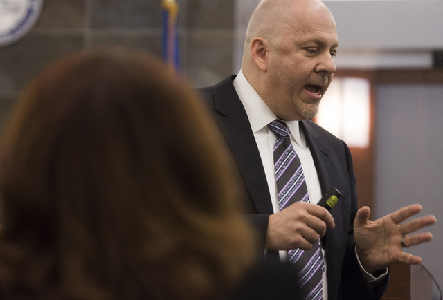 Defense attorney Anthony Sgro,right, representing David Burns, accused of murdering a woman in wounding her daughter, speaks opening statements while Chief Deputy District Attorney Pamela Weckerly ...