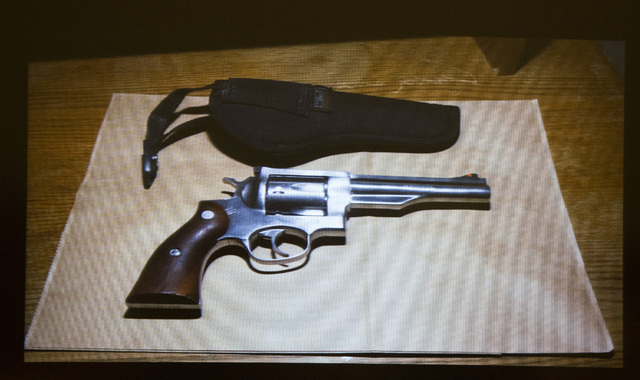 A video screen image of a  Ruger .44 Magnum revolver seen during Willie Darnell Mason,left,  and David Burns, accused of murdering a woman in wounding her daughter, during opening statements Tuesd ...