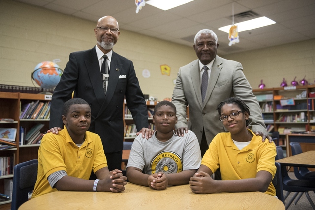 President of the mentorship program of 100 Black Men, Joe  Jones, top left, and vice president of external affairs Leroy Wordlaw, top right, stand behind three young men they are mentoring, from b ...
